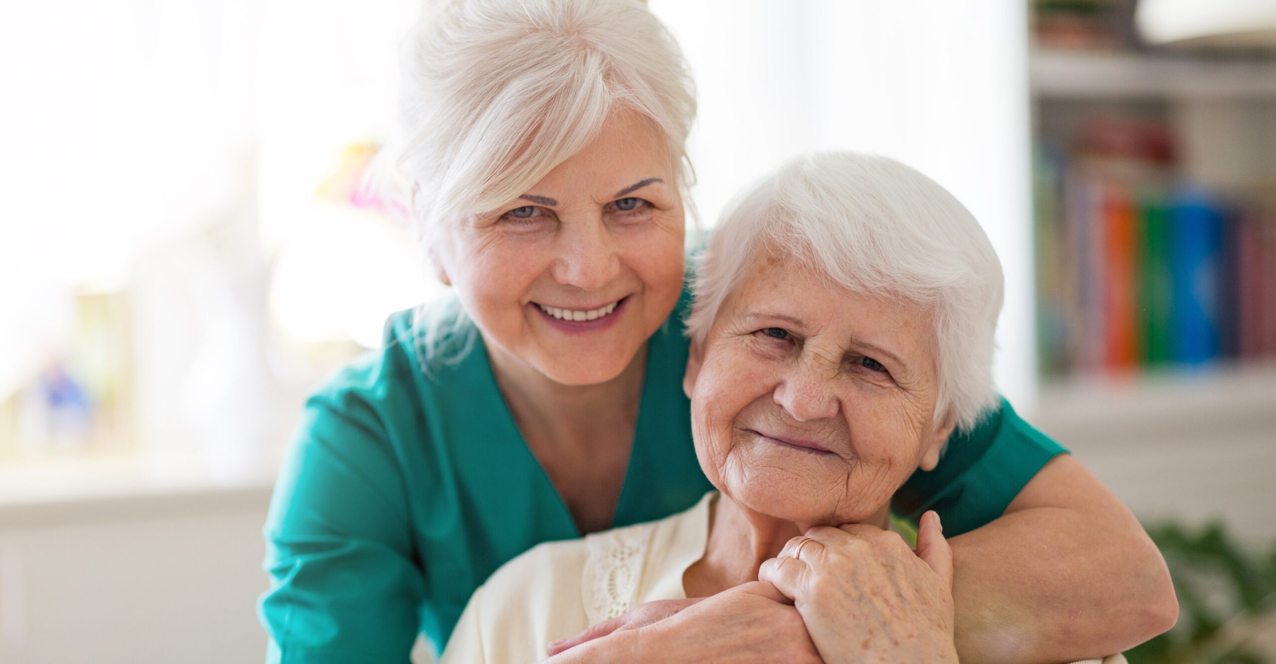A picture of elderly mother and older daughter